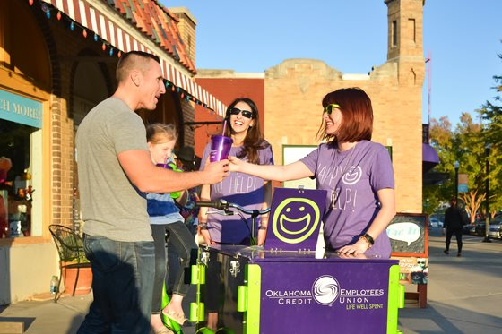 OKCU employees at the Plaza District handing out prizes